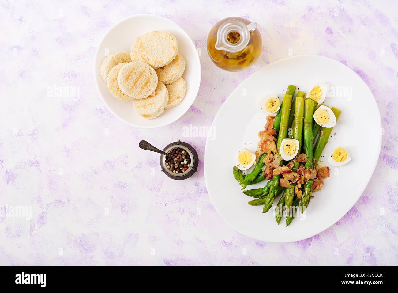 Young shoots of asparagus with ham and quail eggs - Stock Image
