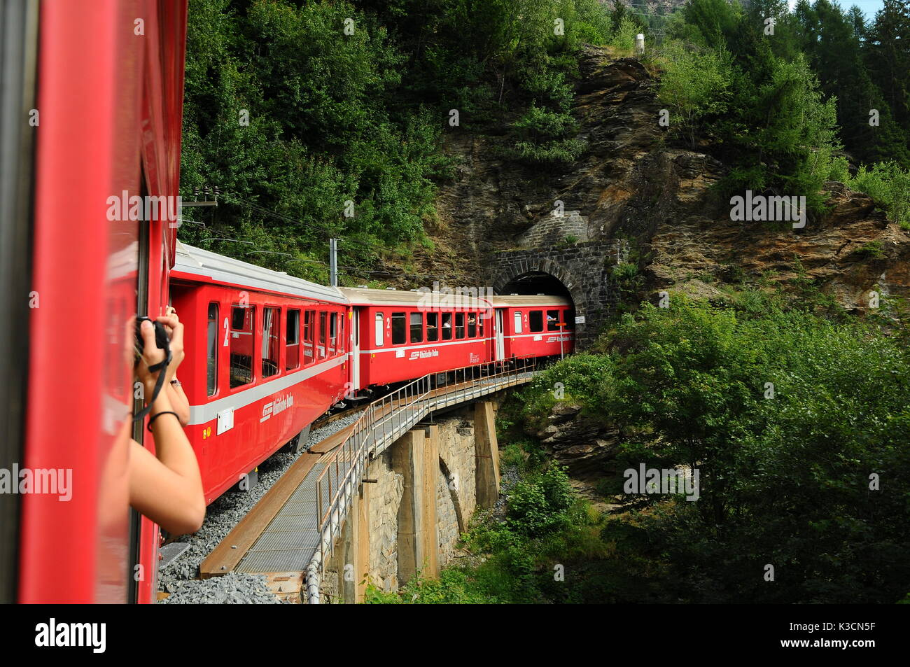 Switzerland:July 2012, Swiss mountain Train Bernina Express from Tirano to St. Moritz - Stock Image