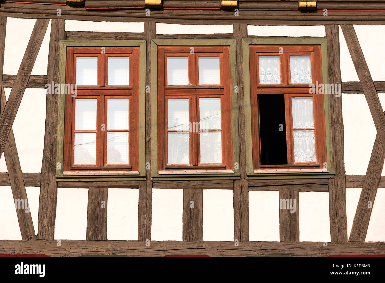 Windows of a traditional half timbered house seen in Germany - Stock Image
