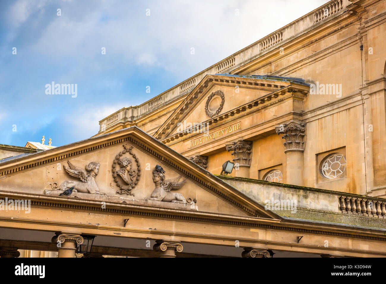 Pump Room Bath UK, view of the pediments adorning the Pump Room and neoclassical portico (foreground) in the centre of the city of Bath, UK. - Stock Image