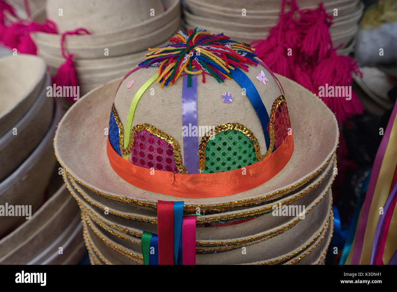 decorated traditional quechua felt hat in the Otavalo artisan market - Stock Image