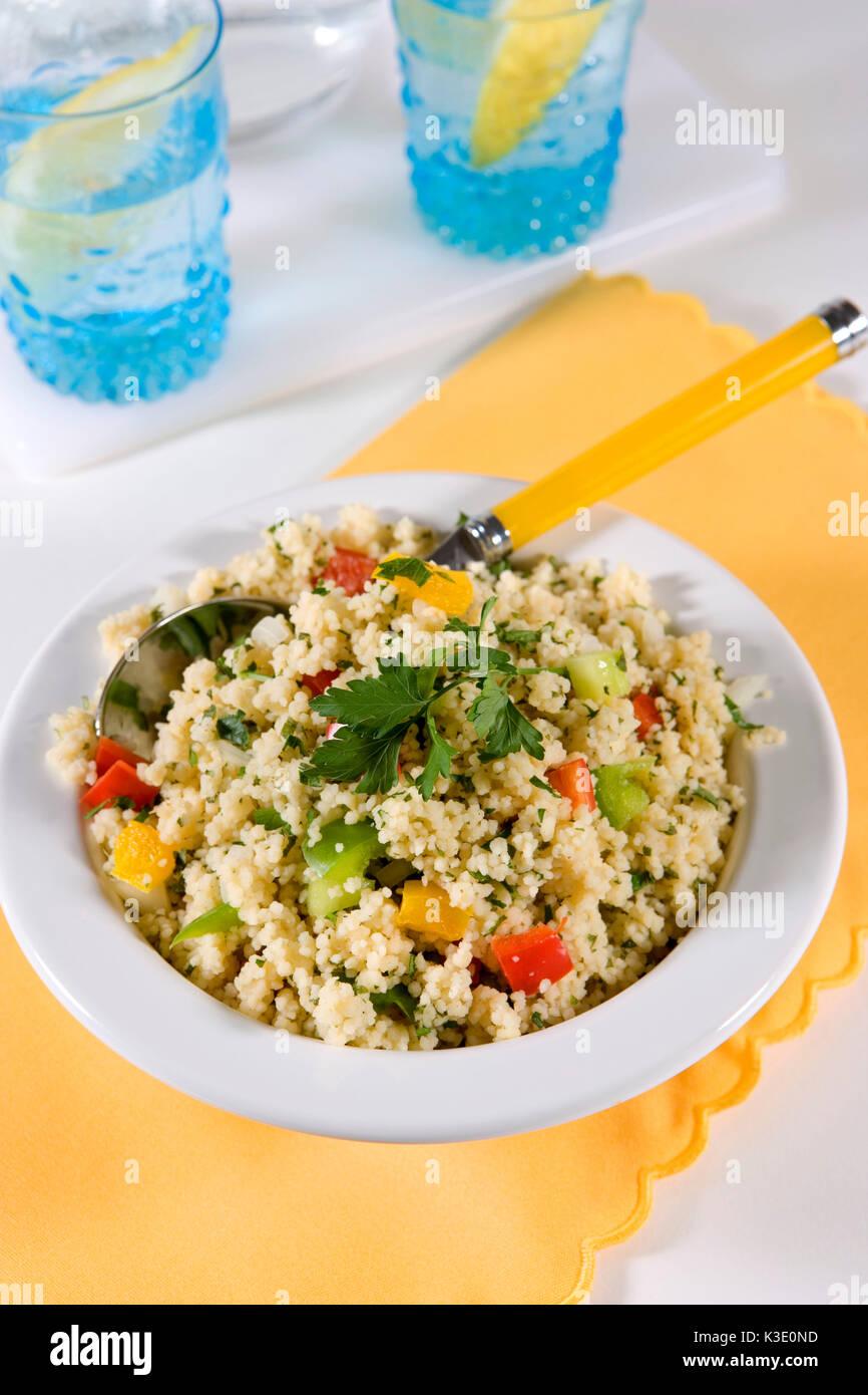 vegetarian dish, Taboulé, couscous salad, Lebanese parsley salad, white plate, spoon, - Stock Image