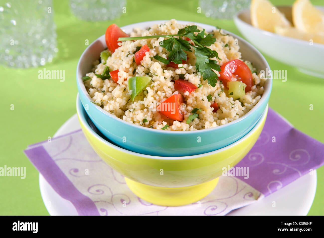 vegetarian dish, Taboulé, couscous salad, Lebanese parsley salad, coloured salad peels, - Stock Image