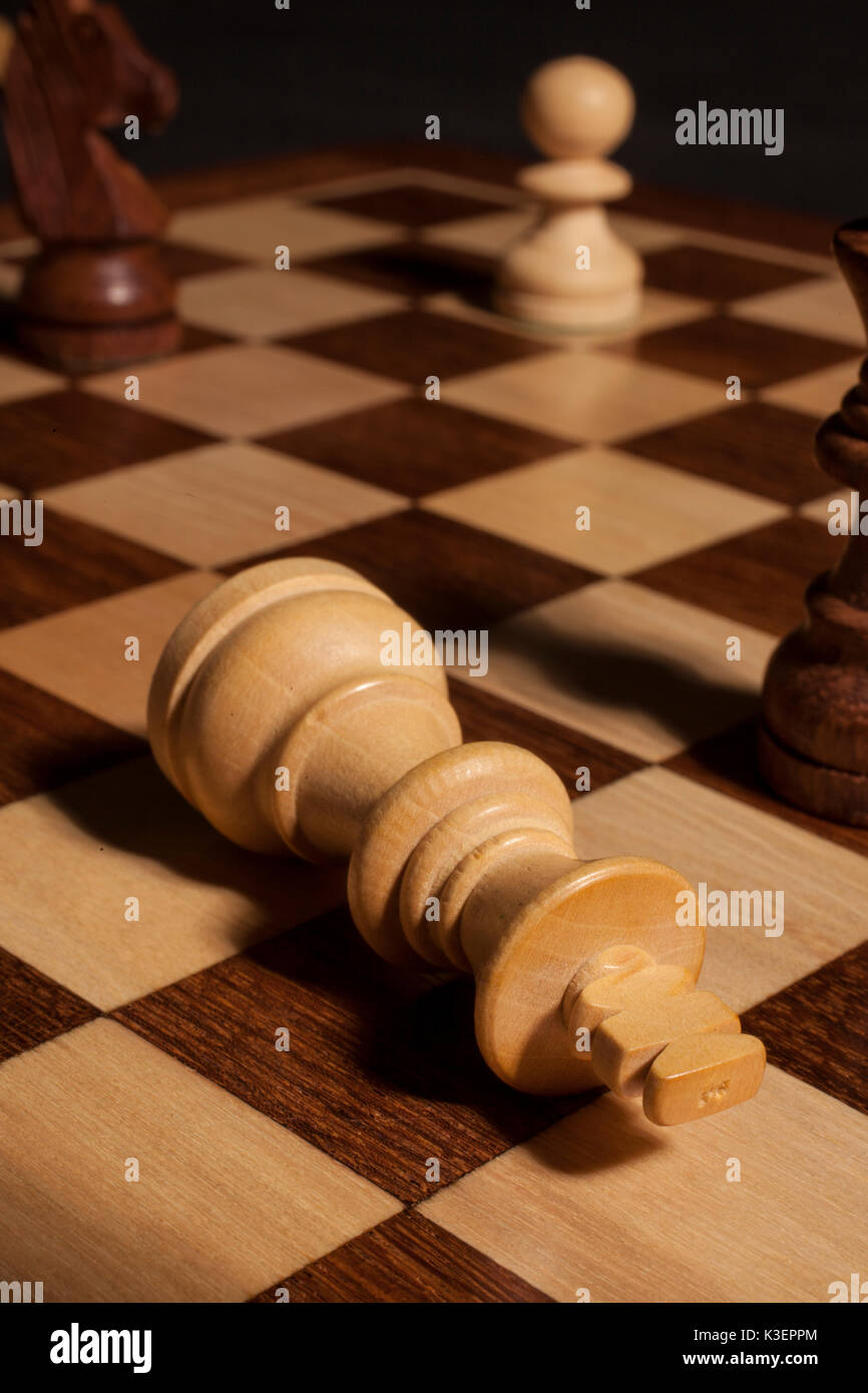 checkmate king piece - Stock Image