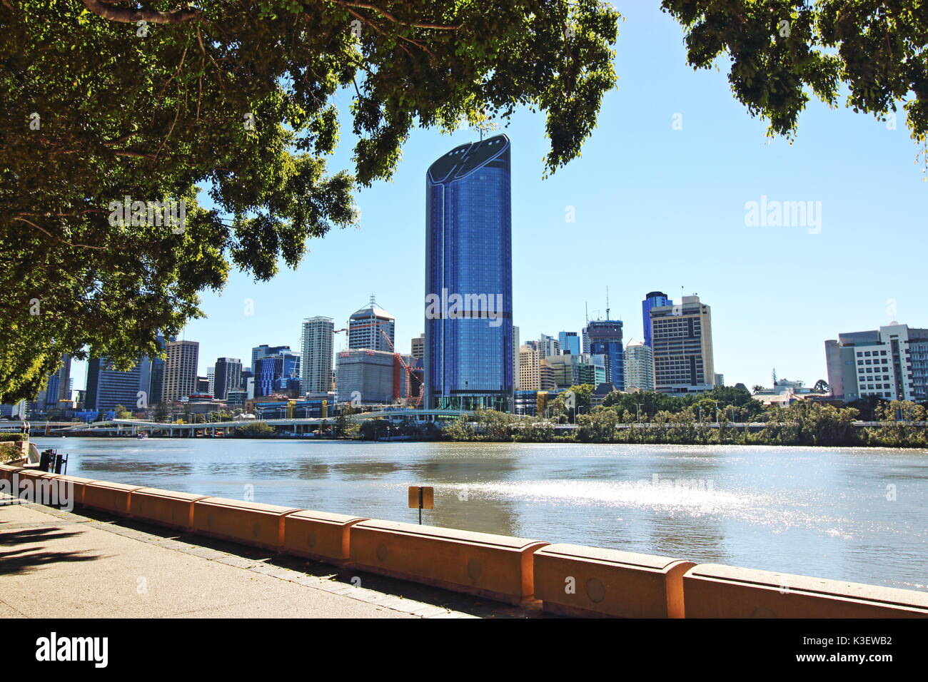 View of Brisbane CBD with the 1 William Street skyscraper in the distance seen from the waterfront of Brisbane River, - Stock Image