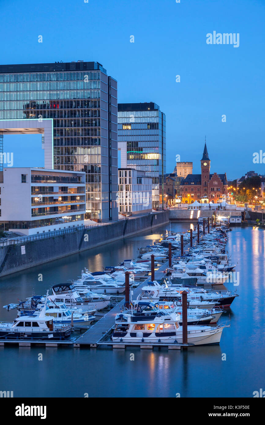 Yacht harbour of the Rheinauhafen (Rheinau harbour), on the left the crane houses of Bothe Richter and Teherani architects and old port authority, Cologne, North Rhine-Westphalia, Germany - Stock Image