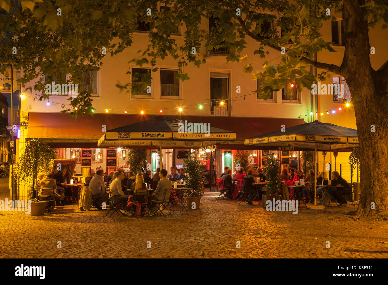 Terrace of the restaurant house Müller in the Severinsviertel Cologne, North Rhine-Westphalia, Germany Stock Photo