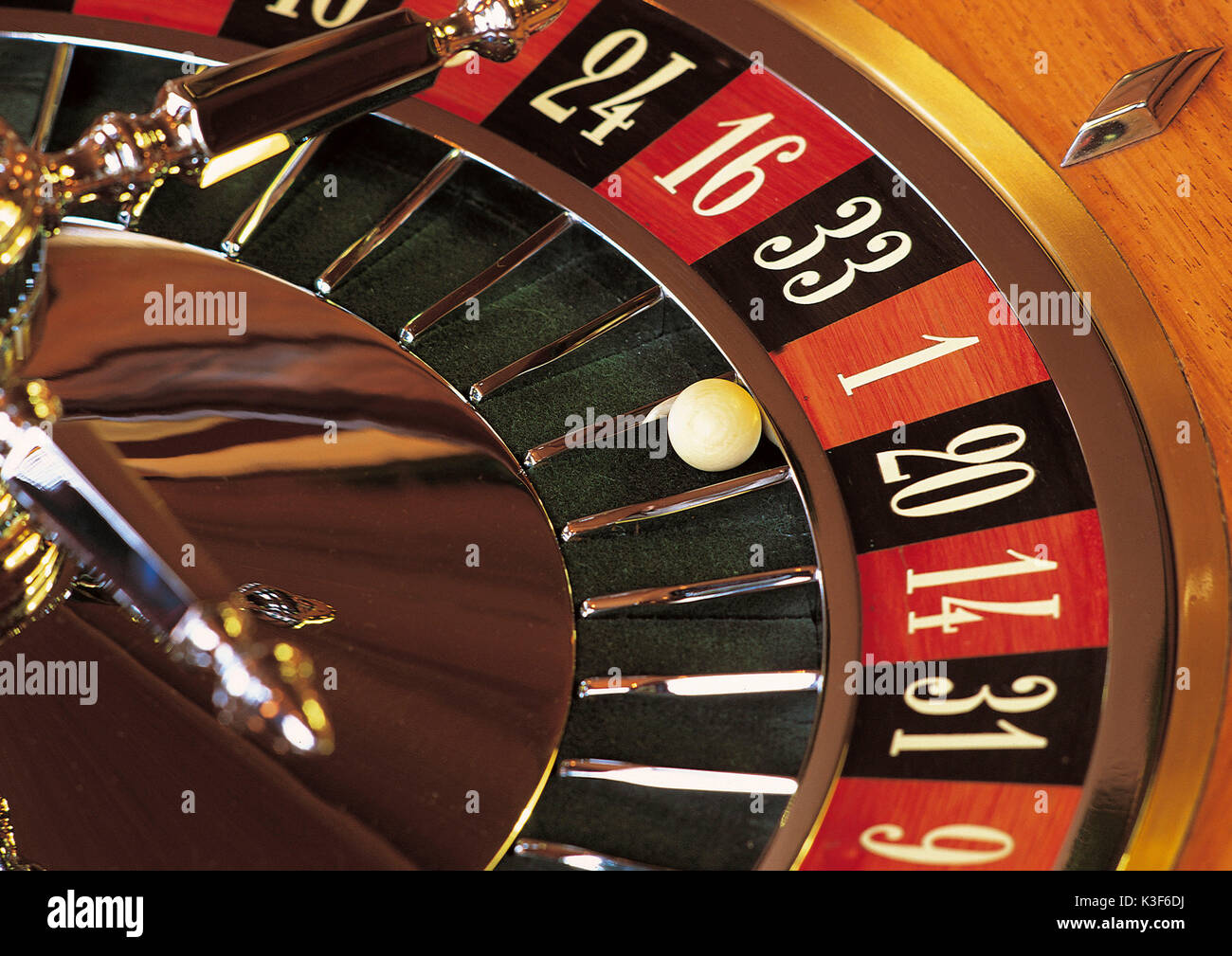 Roulette, ball at the  roulette wheel falls on the red One - Stock Image