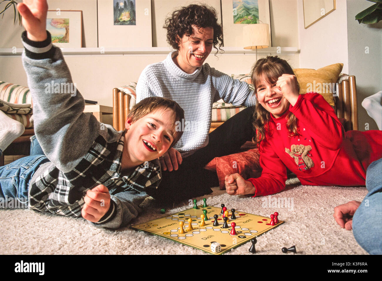 Mother with two children while playing Ludo Stock Photo
