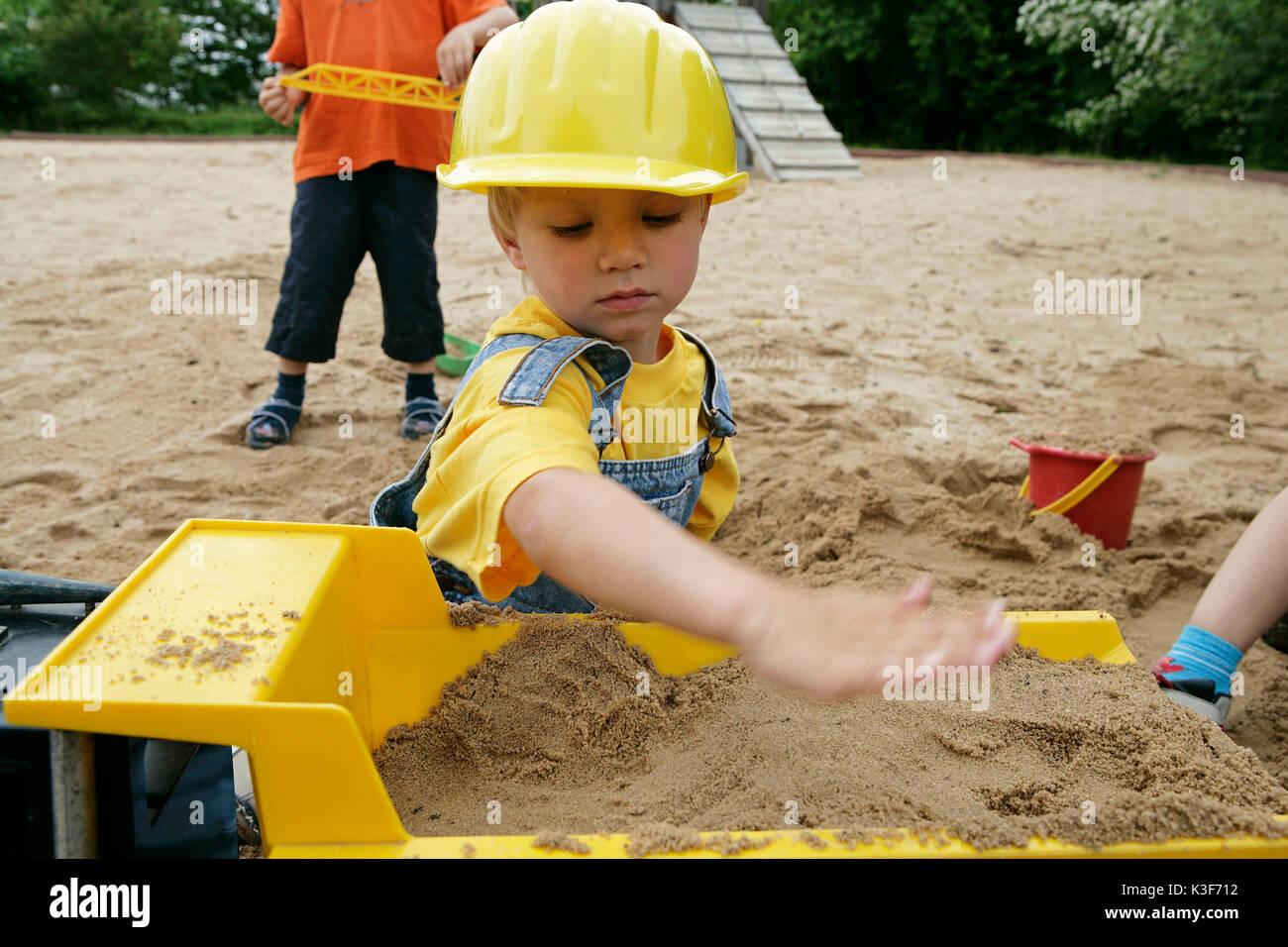 Child at the sandbox - Stock Image