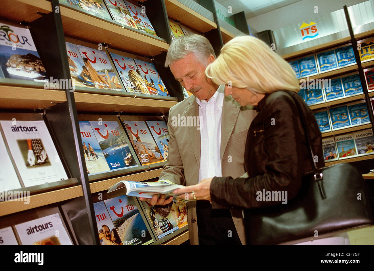 Couple at the travel agency - Stock Image