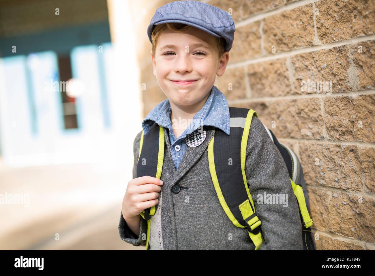 Pre teen boy at school - Stock Image
