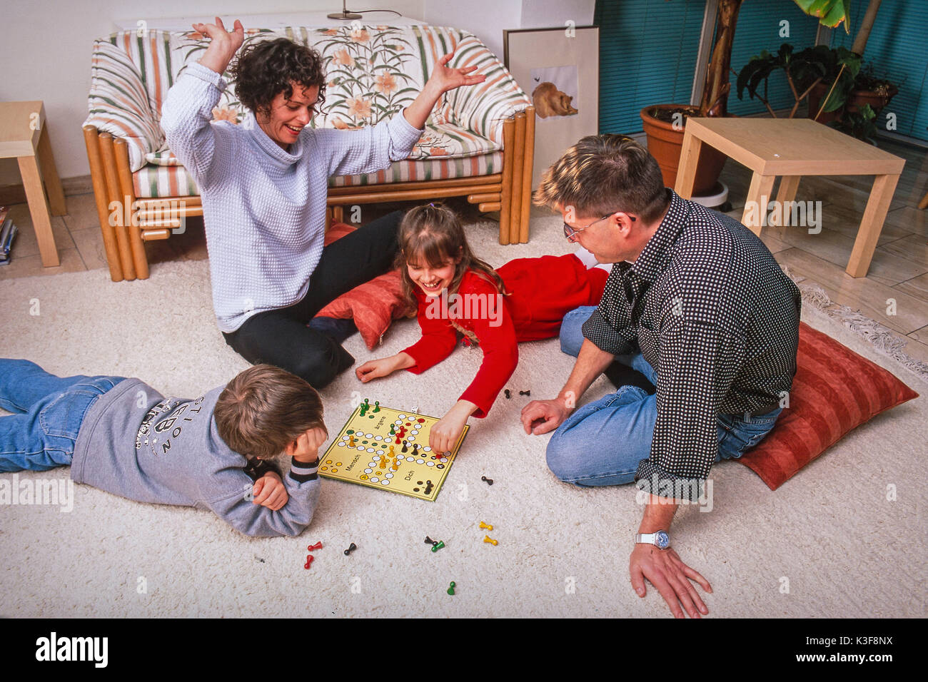 family at playing Ludo Stock Photo