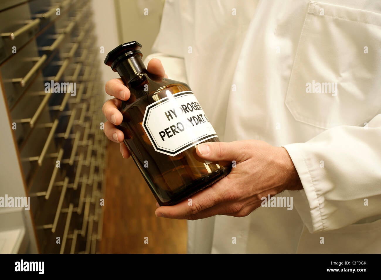 chemist with chemist bottle in the hands - Stock Image