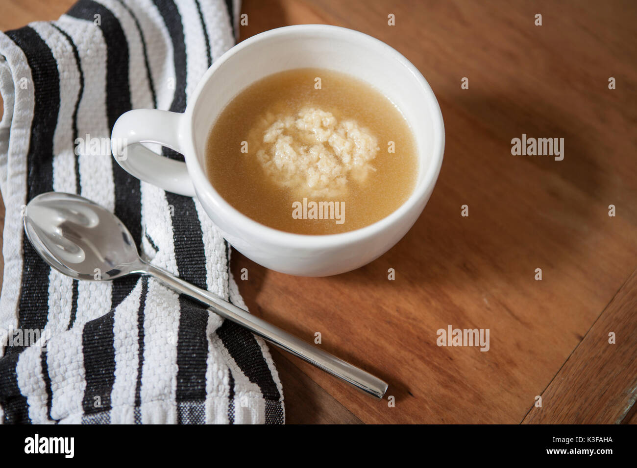 High Angle View of Cup of Matzah Ball Soup - Stock Image