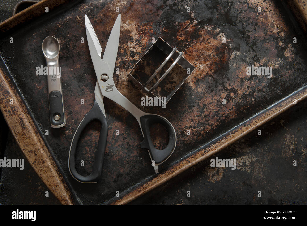 Baking Tray with Scissors, Square Cutter and Measuring Spoon - Stock Image