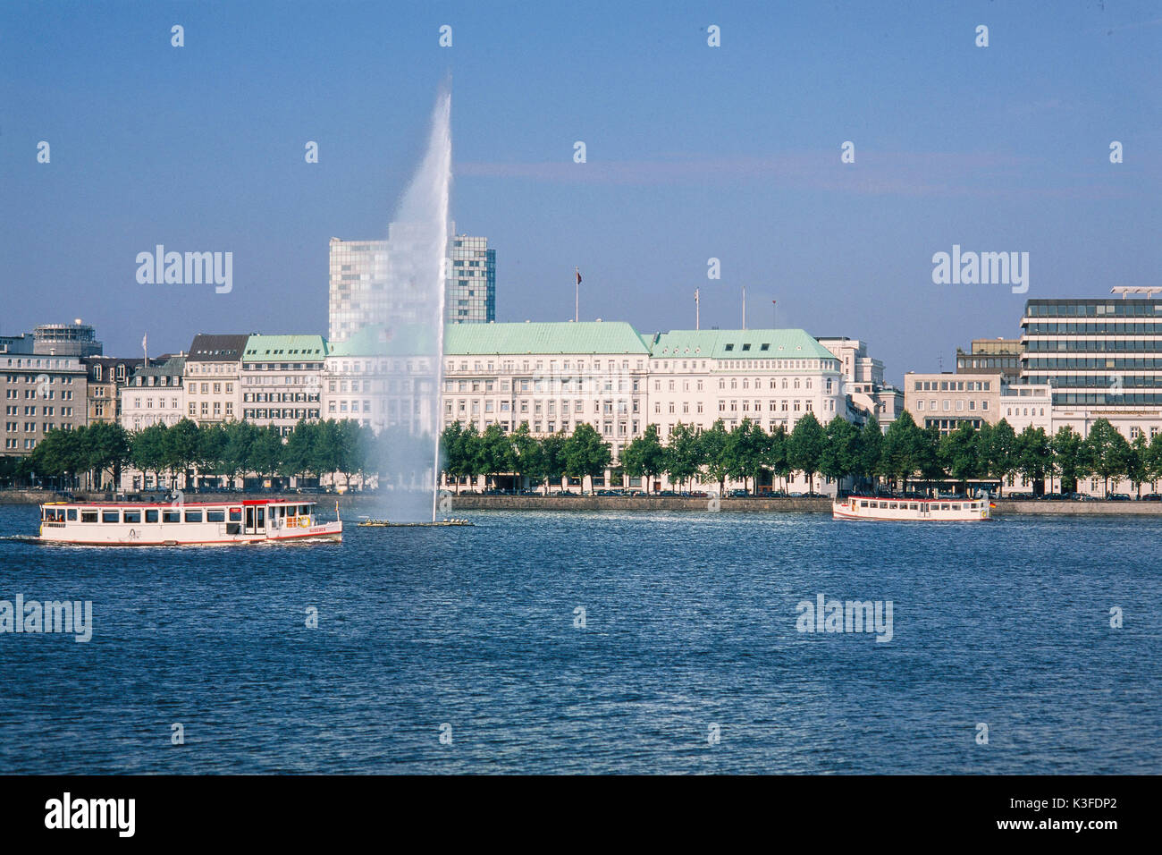 Water jet on the Inner Alster in front of the Fairmont hotel Four seasons, Hamburg Stock Photo