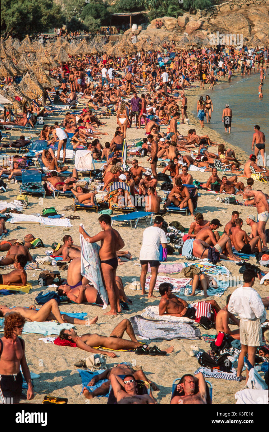 Congested holiday beach, Mykonos, Greece - Stock Image