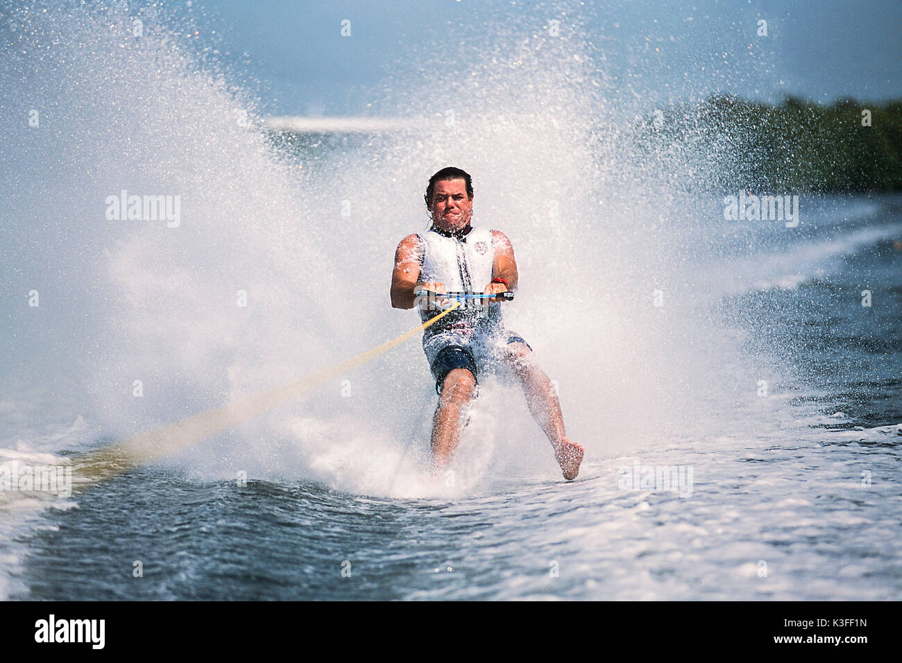Barefooted water-ski driver - Stock Image