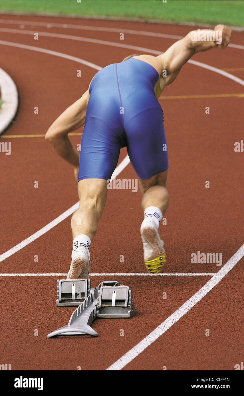 Sprinter while starting from the starting block - Stock Image