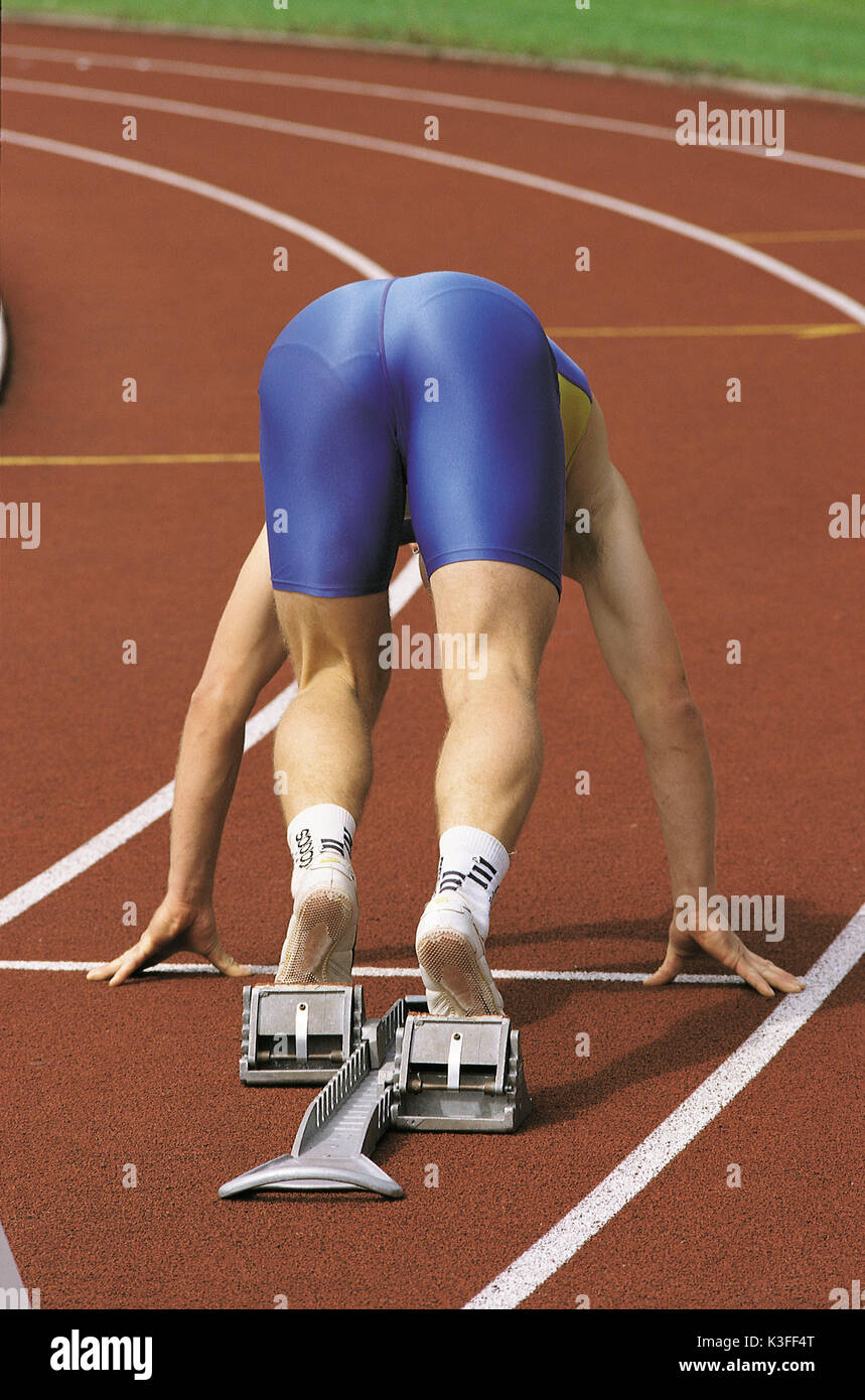 Sprinter at the starting block shortly before the race - Stock Image
