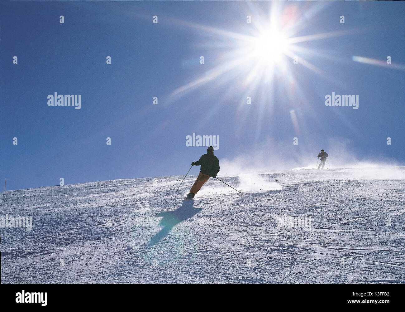 Skier drives downhill - Stock Image