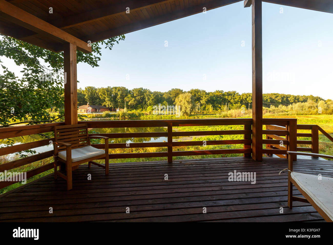 wood terrace on lake in cottage - Stock Image