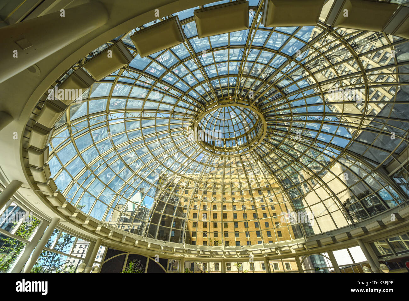 VANCOUVER, CANADA - MAY 25, 2017: The dome-shaped glass rotunda is an entrance into the CF Pacific Centre shopping mall in downtown Vancouver. - Stock Image