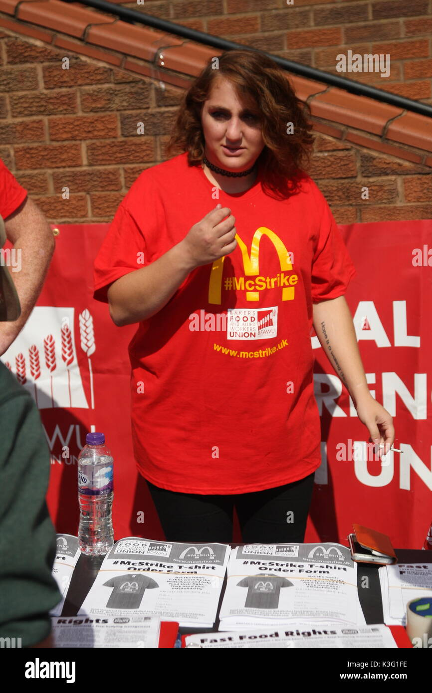 London, UK, 2nd September 2017.Mc Donalds workers and their supporters rally outside the company's HQ in East Finchley. The Bakers Food and Allied Workers Union (BFAWU) organised the rally which precedes a strike at two McDonalds branches on Monday. Pictured;  McDonalds striker Shen Batmaz wearing the 'McStrike' T-shirt.  Roland Ravenhill/Alamy Live News - Stock Image