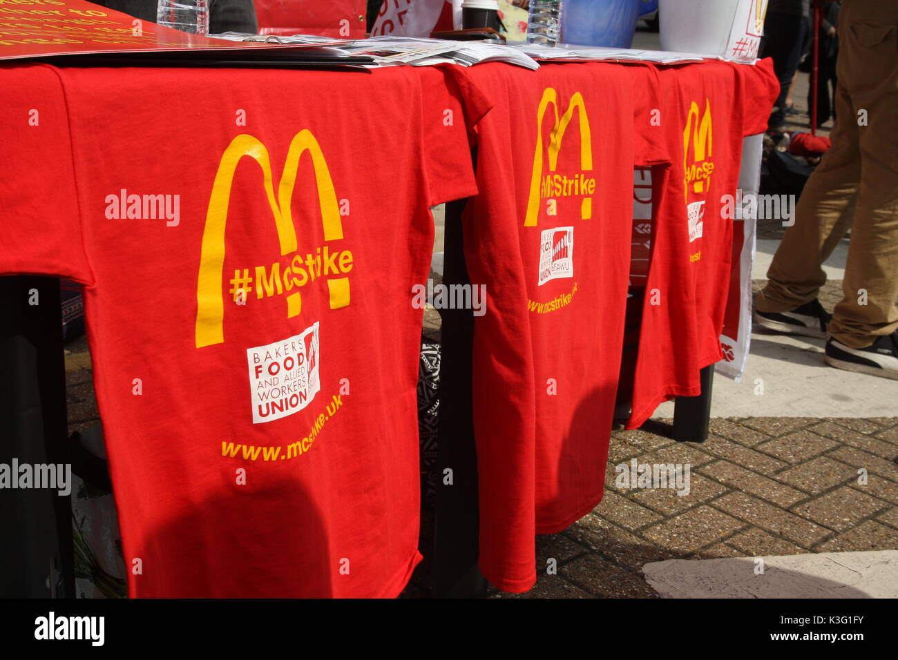 London, UK, 2nd September 2017.Mc Donalds workers and their supporters rally outside the company's HQ in East Finchley. The Bakers Food and Allied Workers Union (BFAWU) organised the rally which precedes a strike at two McDonalds branches on Monday. 'McStrike' T-shirts hang from a campaign stall.  Roland Ravenhill/Alamy Live News - Stock Image