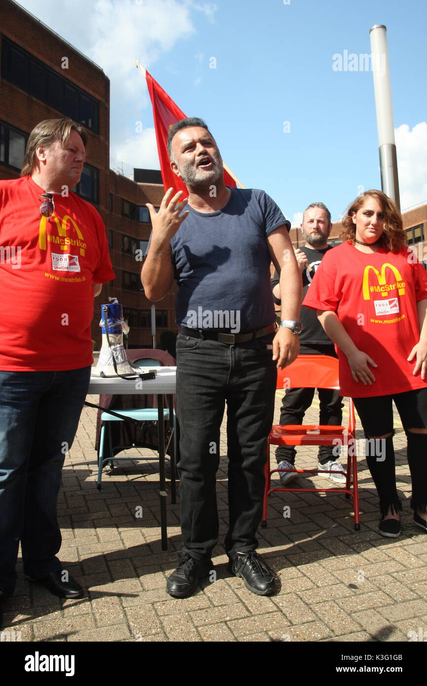 London, UK, 2nd September 2017.Mc Donalds workers and their supporters rally outside the company's HQ in East Finchley. The Bakers Food and Allied Workers Union (BFAWU) organised the rally which precedes a strike at two McDonalds branches on Monday. Pictured; Matt McCarten, a speaker from the New Zealand union Unite which has campaigned against McDonalds with Ian Hodson, national president BFAWU, and Shen Batmaz a striking McDonalds worker. Roland Ravenhill/Alamy Live News - Stock Image