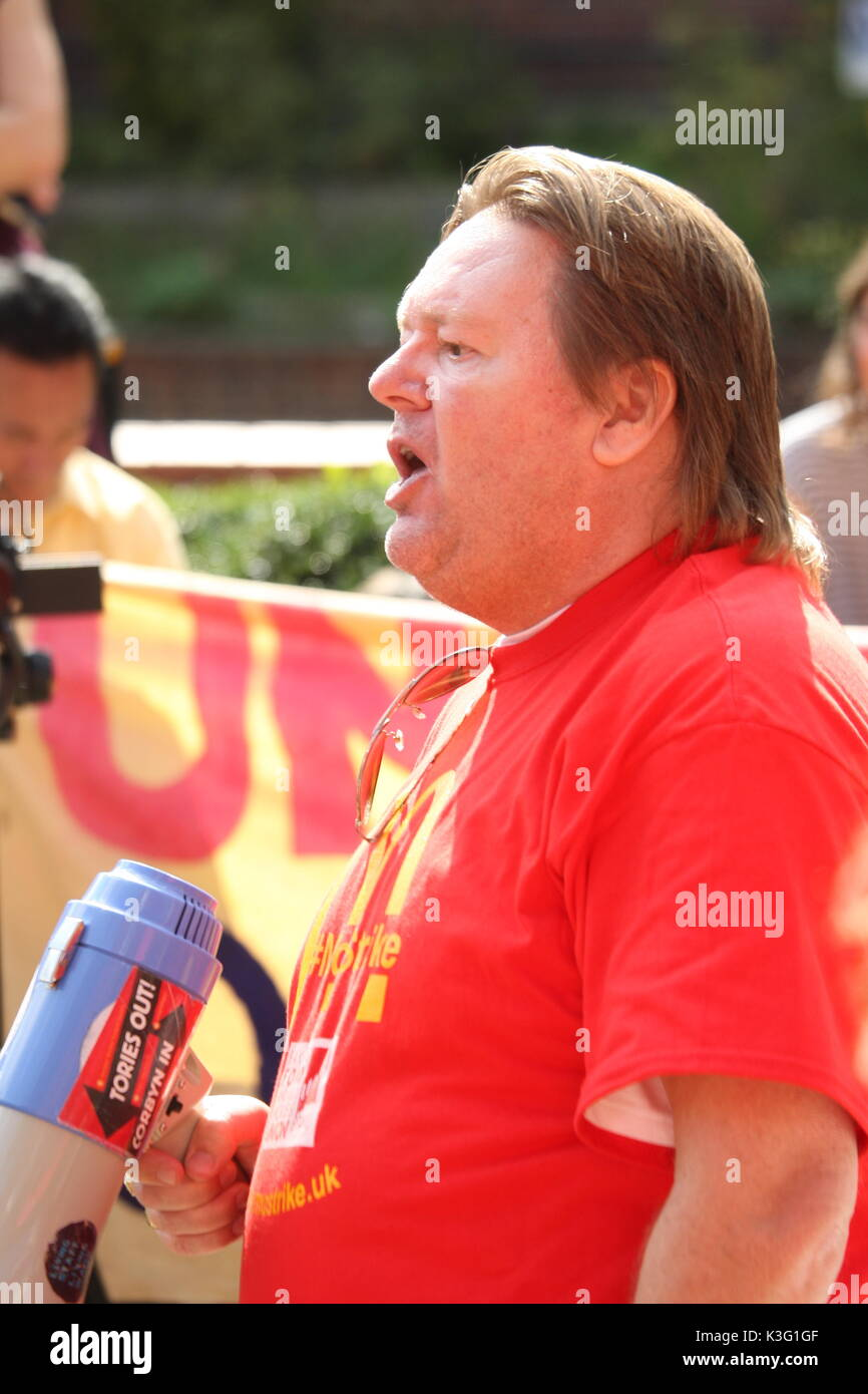 London, UK, 2nd September 2017.Mc Donalds workers and their supporters rally outside the company's HQ in East Finchley. The Bakers Food and Allied Workers Union (BFAWU) organised the rally which precedes a strike at two McDonalds branches on Monday. Pictured; Ian Hodson, national president BFAWU speaks to the crowd. Roland Ravenhill/Alamy Live News - Stock Image