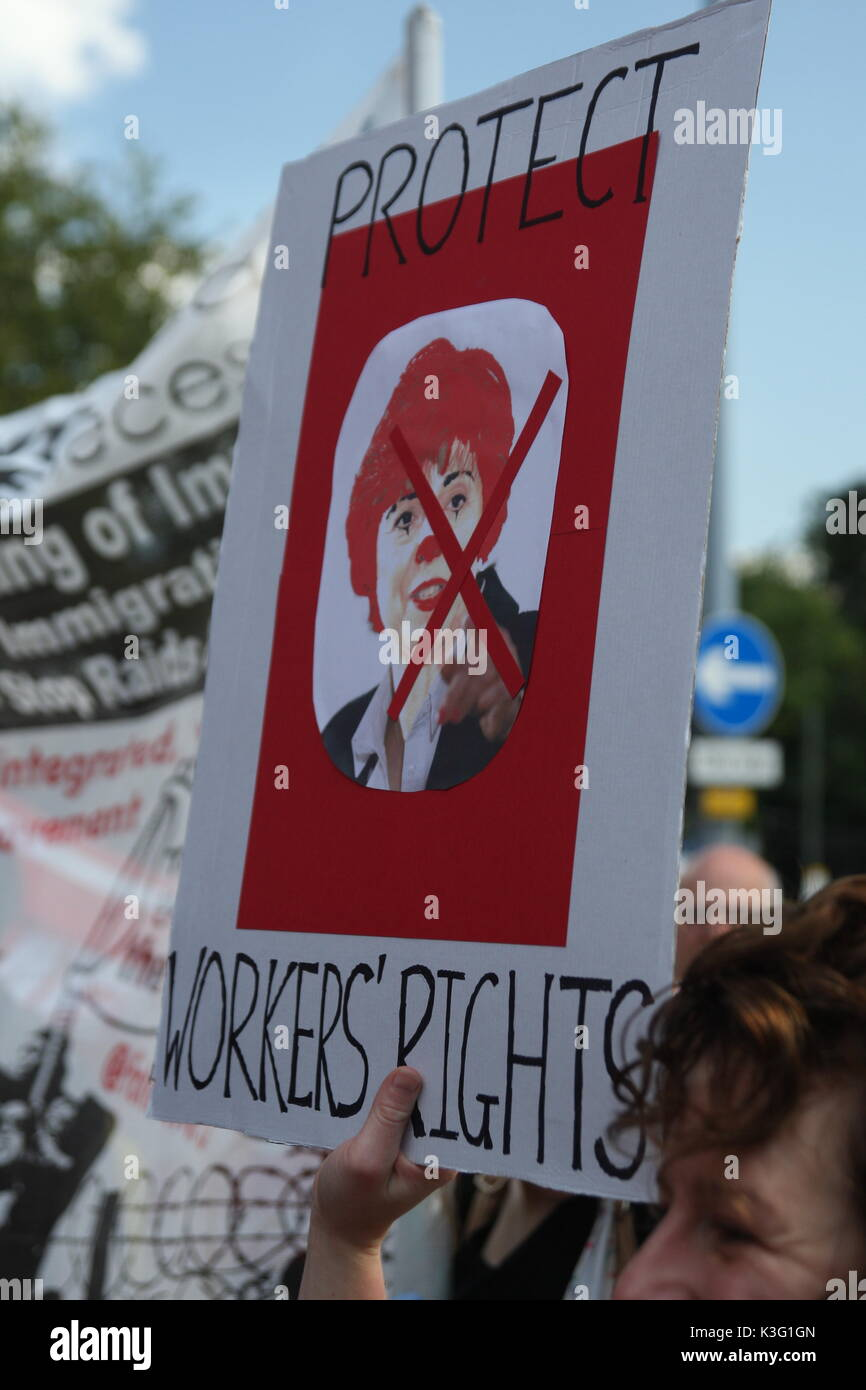 London, UK, 2nd September 2017.Mc Donalds workers and their supporters rally outside the company's HQ in East Finchley. The Bakers Food and Allied Workers Union (BFAWU) organised the rally which precedes a strike at two McDonalds branches on Monday. Ronald McDonald's face appears on a placard along with the slogan 'protect worker's rights'.  Roland Ravenhill/Alamy Live News - Stock Image