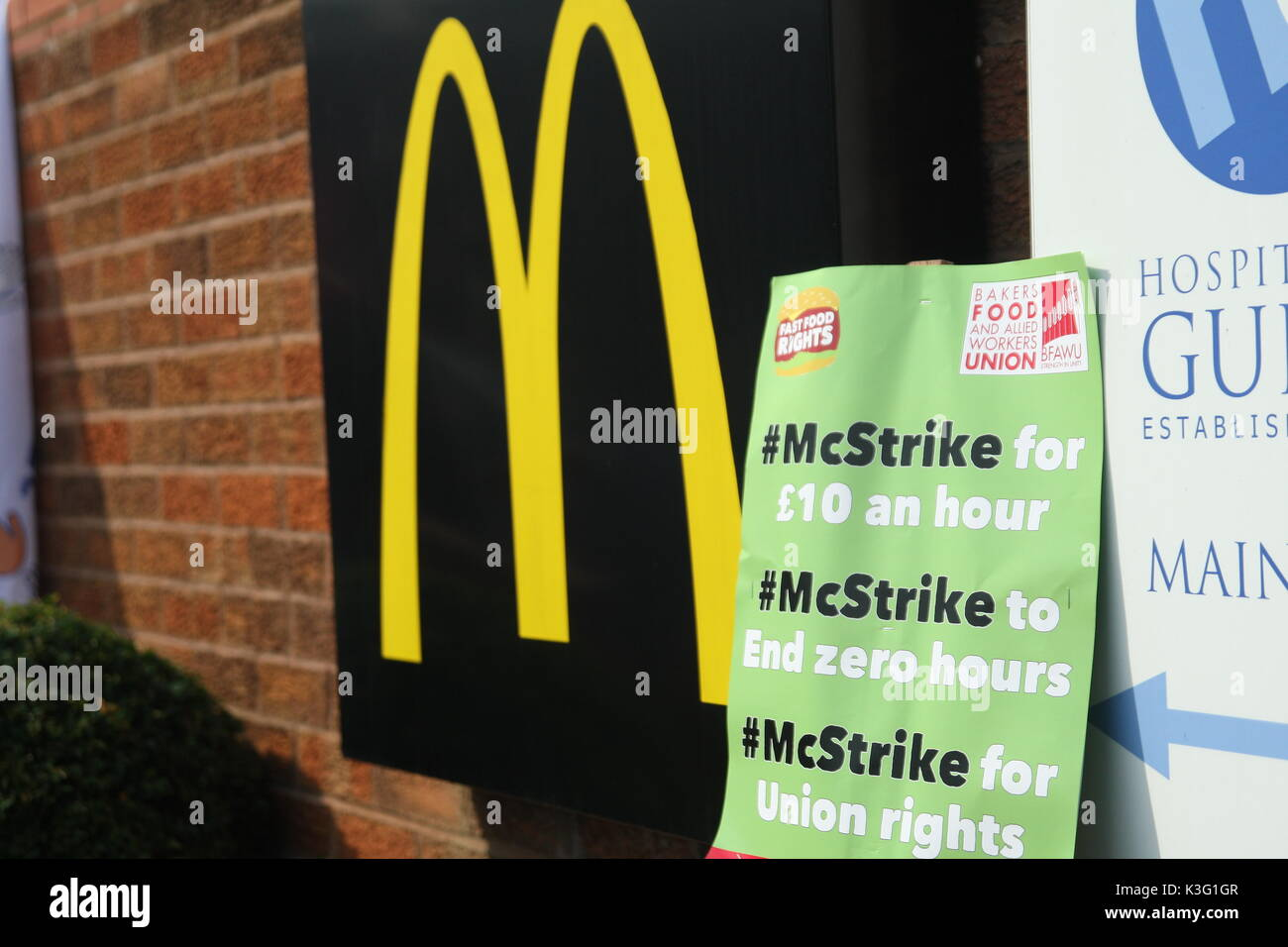 London, UK, 2nd September 2017.Mc Donalds workers and their supporters rally outside the company's HQ in East Finchley. The Bakers Food and Allied Workers Union (BFAWU) organised the rally which precedes a strike at two McDonalds branches on Monday. A placard leans against the McDonalds logo, it says: 'McStrike for £10 an hour, McStrike to end zero hours, McStrike for union rights'. Roland Ravenhill/Alamy Live News - Stock Image