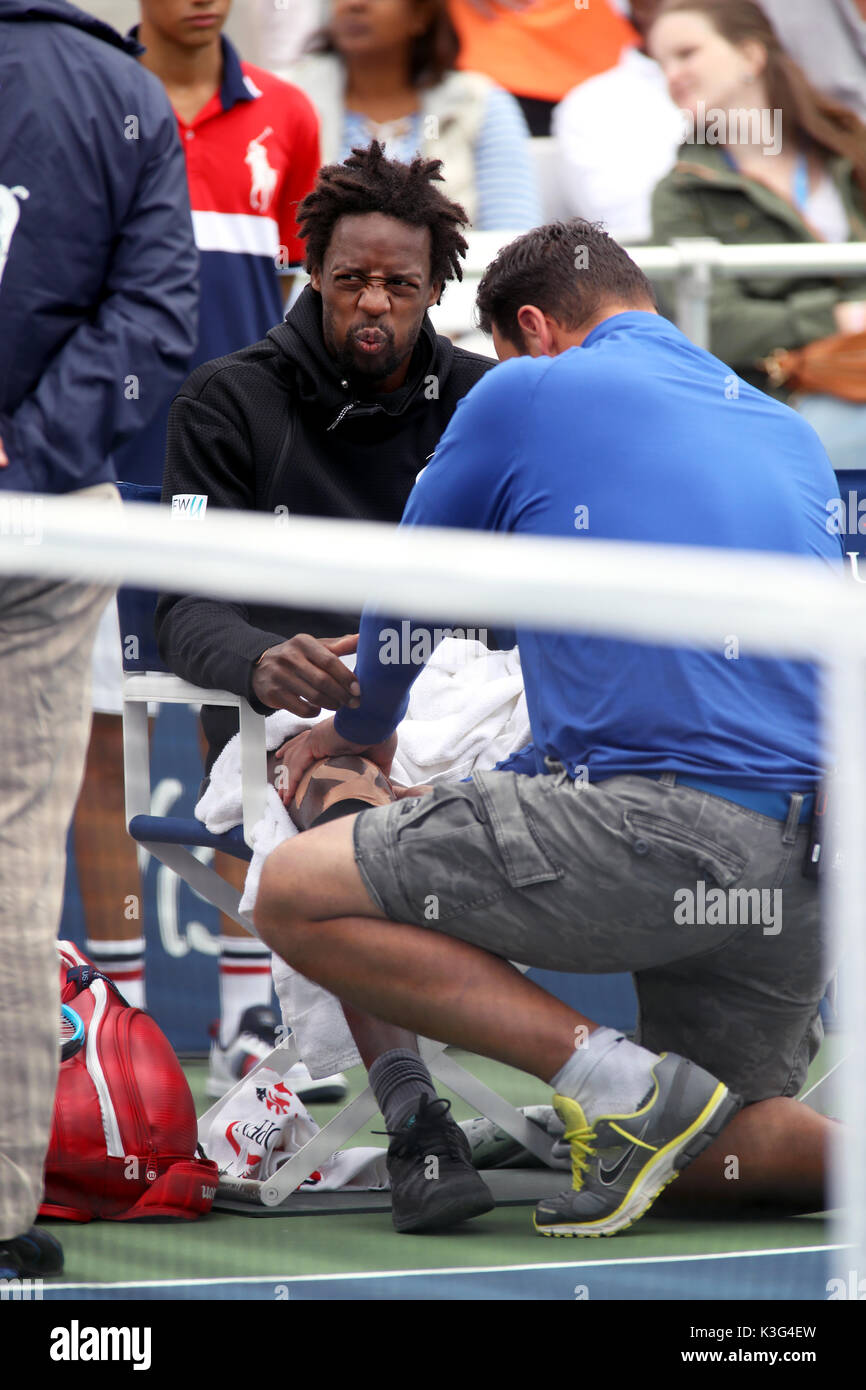 New York, USA. 2nd September, 2017. Gael Monfils of France winces as he receives treatment from the trainer during a medical timeout in his third round match against David Goffin of Belgium  at the US Open in Flushing Meadows, New York.  Monfils retired with an injury in the second set. Credit: Adam Stoltman/Alamy Live News - Stock Image