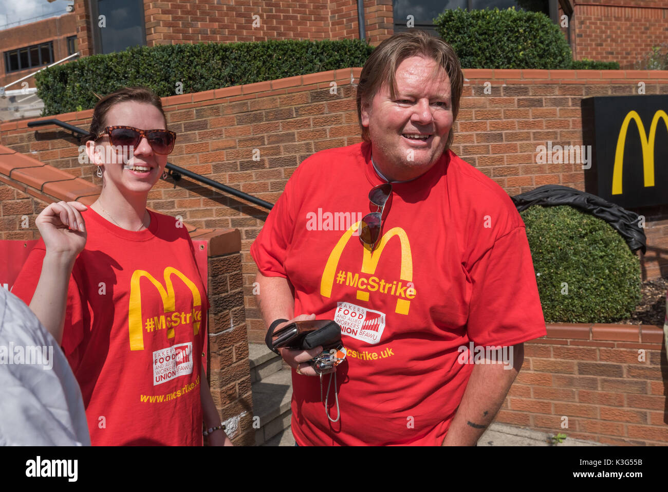 London, UK. 2nd September 2017. Bakers, Food and Allied Workers Union (BFAWU) President Ian Hodson  with one of the strikers outside McDonald's London HQ for a support rally in advance of the first UK strike against the company on Monday, US Labor Day. The workers demand an end to zero hours contracts, £10 an hour and union recognition.  Bakers, Food and Allied Workers Union Credit: Peter Marshall/Alamy Live News - Stock Image