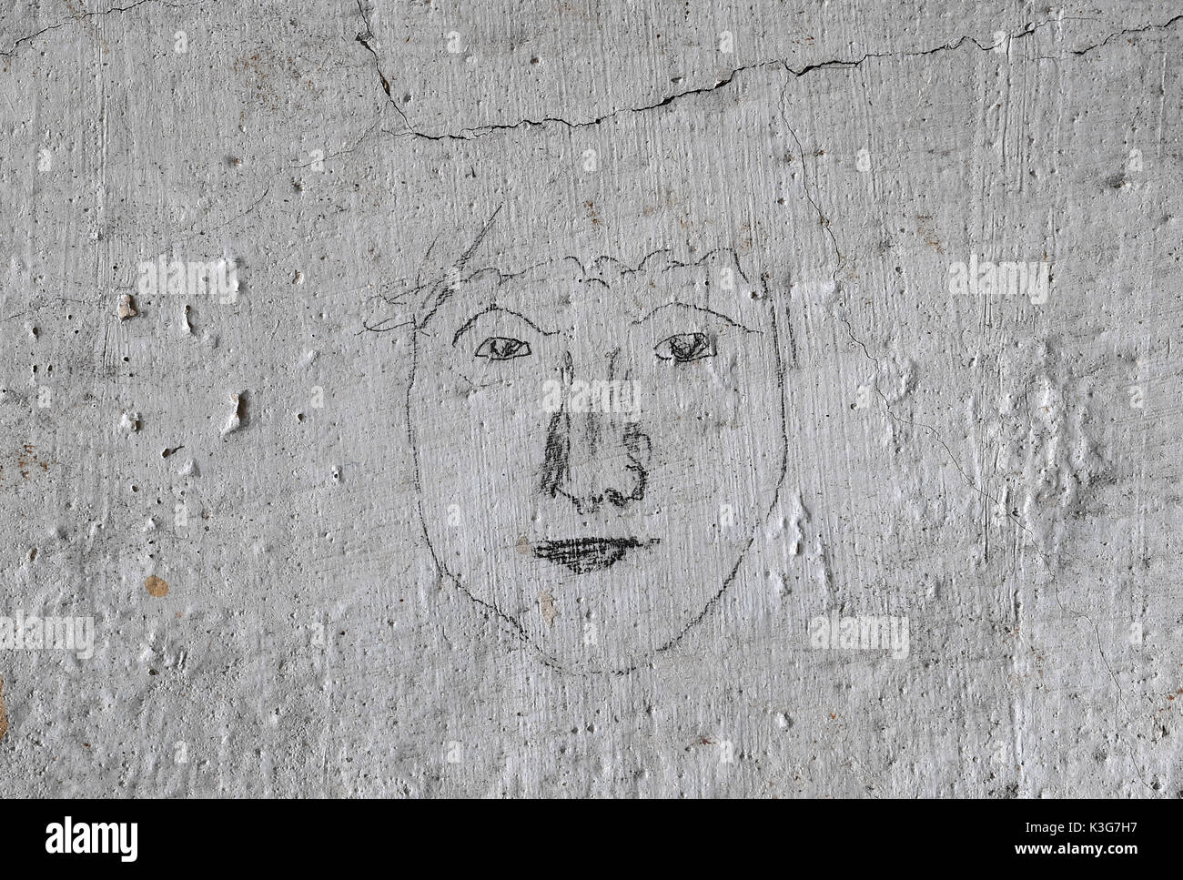 Frankenberg, Germany. 23rd Aug, 2071. FILE - Archival material shows a face at the wall in a cell in the former concentration camp Sachsenburg in Frankenberg, Germany, 23 August 2071. The Nazi organisations SA and SS imprisoned more than 2000 critics of the regime in the former spinning mill between 1933 and 1937. The political parties Die Linke (Left Party) and Die Gruenne (Alliance 90/The Greens) plan to transform the factory into a memorial. Photo: Hendrik Schmidt/dpa-Zentralbild/ZB/dpa/Alamy Live News - Stock Image