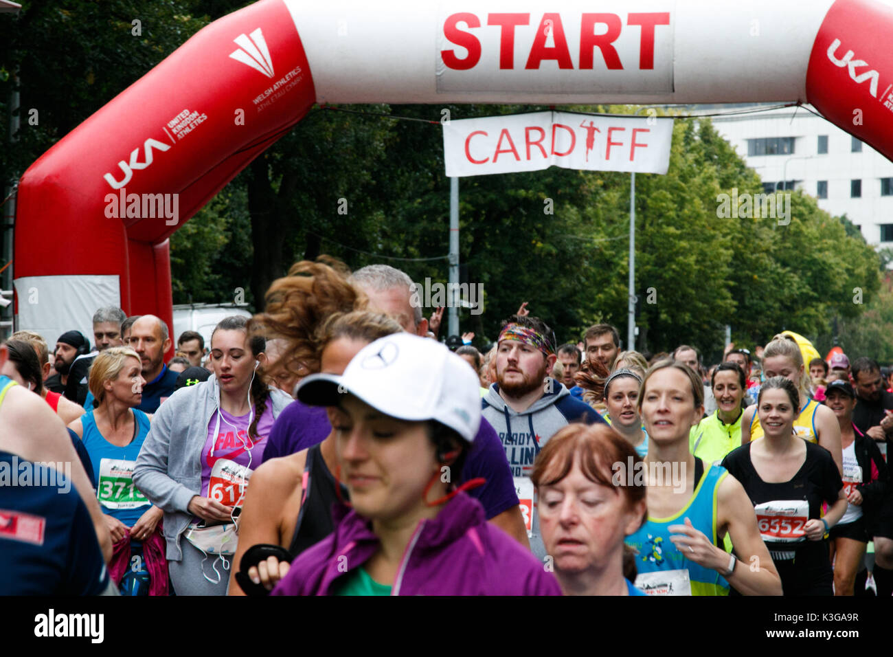 Cardiff 10K, South Wales, UK.  3 September 2017.  UK Weather: 2500 runners brave the rain to take part in the Cardiff 10K run this morning at 10am.  Runners are raising money for Kidney Wales. Credit: Andrew Bartlett/Alamy Live News. - Stock Image