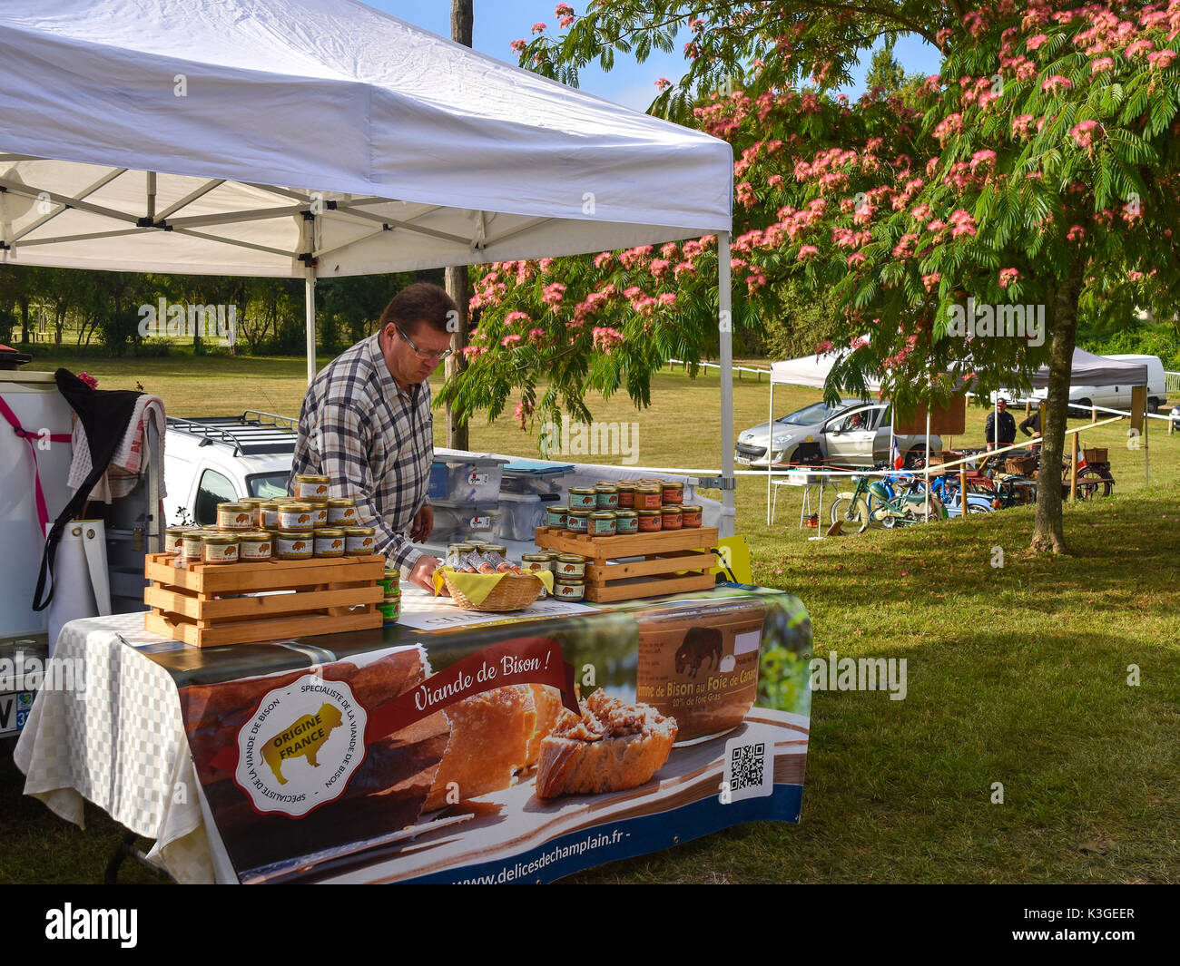 Bison meat seller at country fair, Bossay-sur-Claise, France. - Stock Image