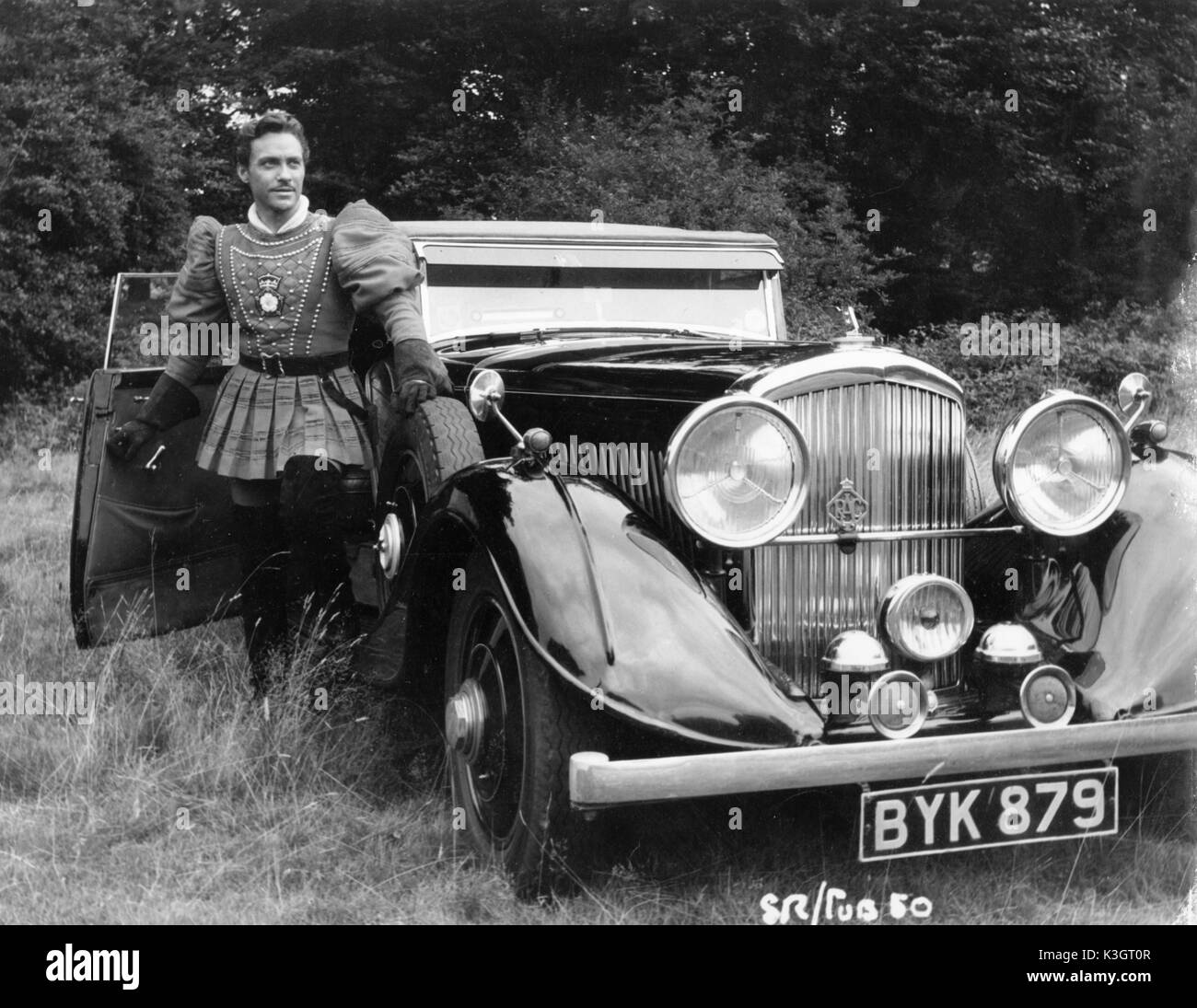 RICHARD TODD WITH HIS BENTLEY DURING THE FILMING OF THE SWORD AND ...