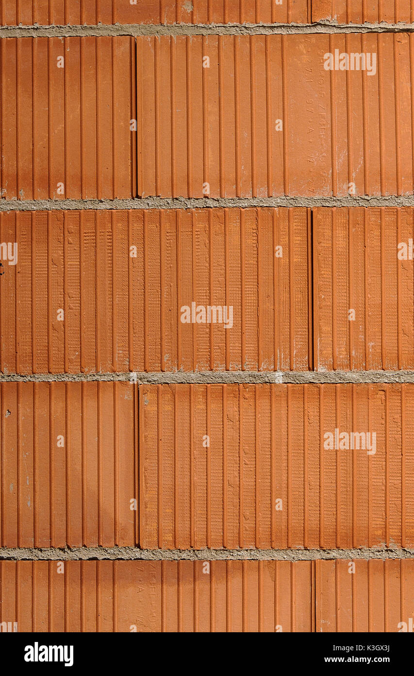 Wall from red bricks - Stock Image