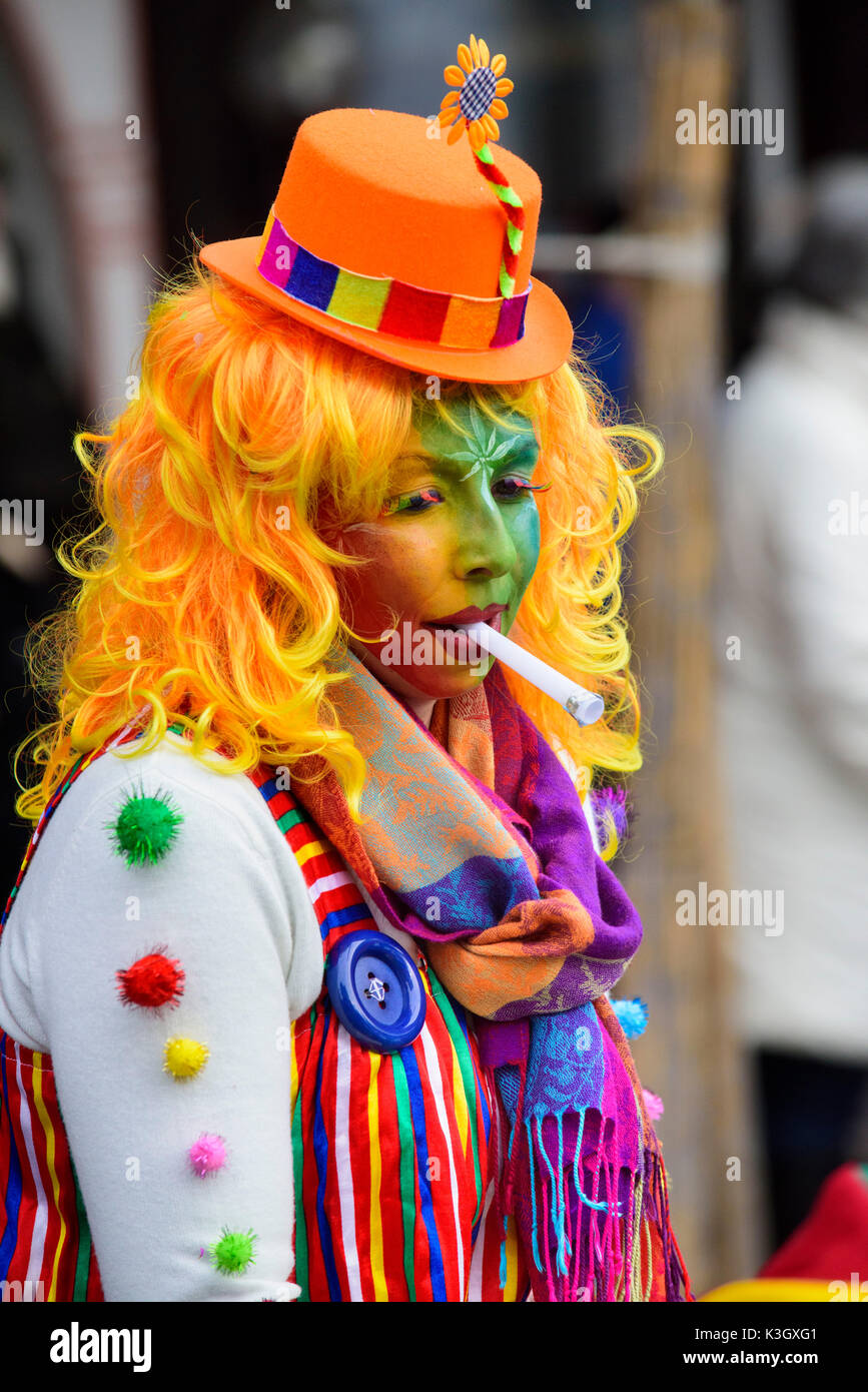 carnival procession on the high street of Bad Hindelang on carnival Sunday with many artistic masks, as for example clown - Stock Image