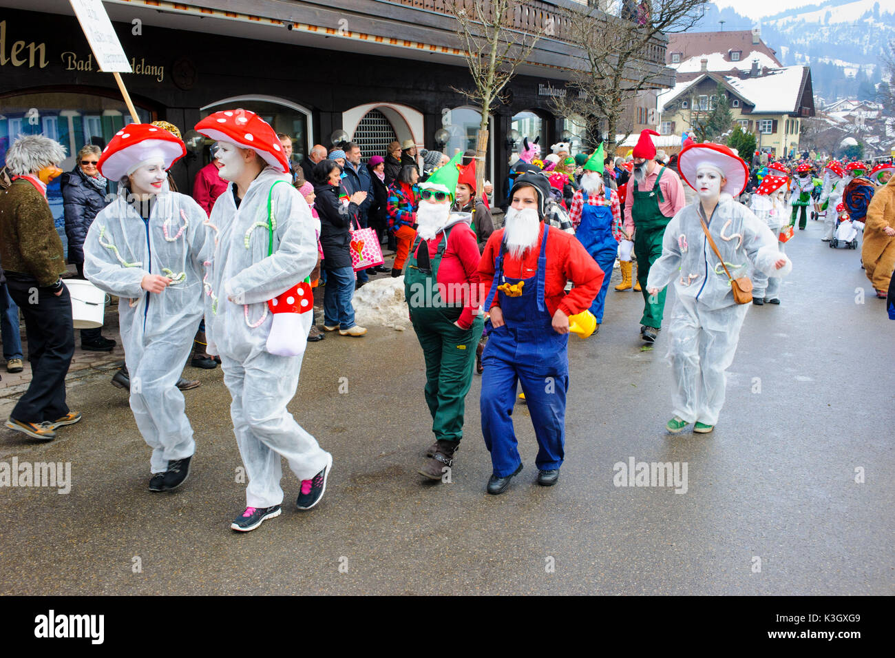 carnival procession on the high street of Bad Hindelang on carnival Sunday with many artistic masks, as for example toadstool - Stock Image