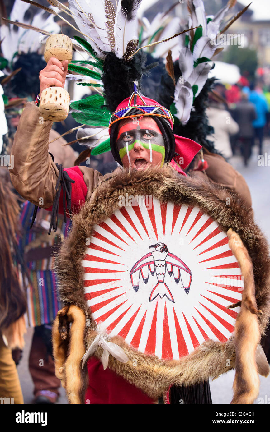 carnival procession on the high street of Bad Hindelang on carnival Sunday with many artistic masks, as for example Indian - Stock Image