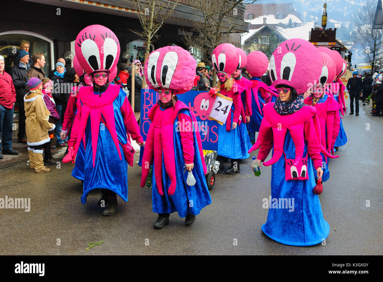 carnival procession on the high street of Bad Hindelang on carnival Sunday with many artistic masks, as for example cuttlefish - Stock Image