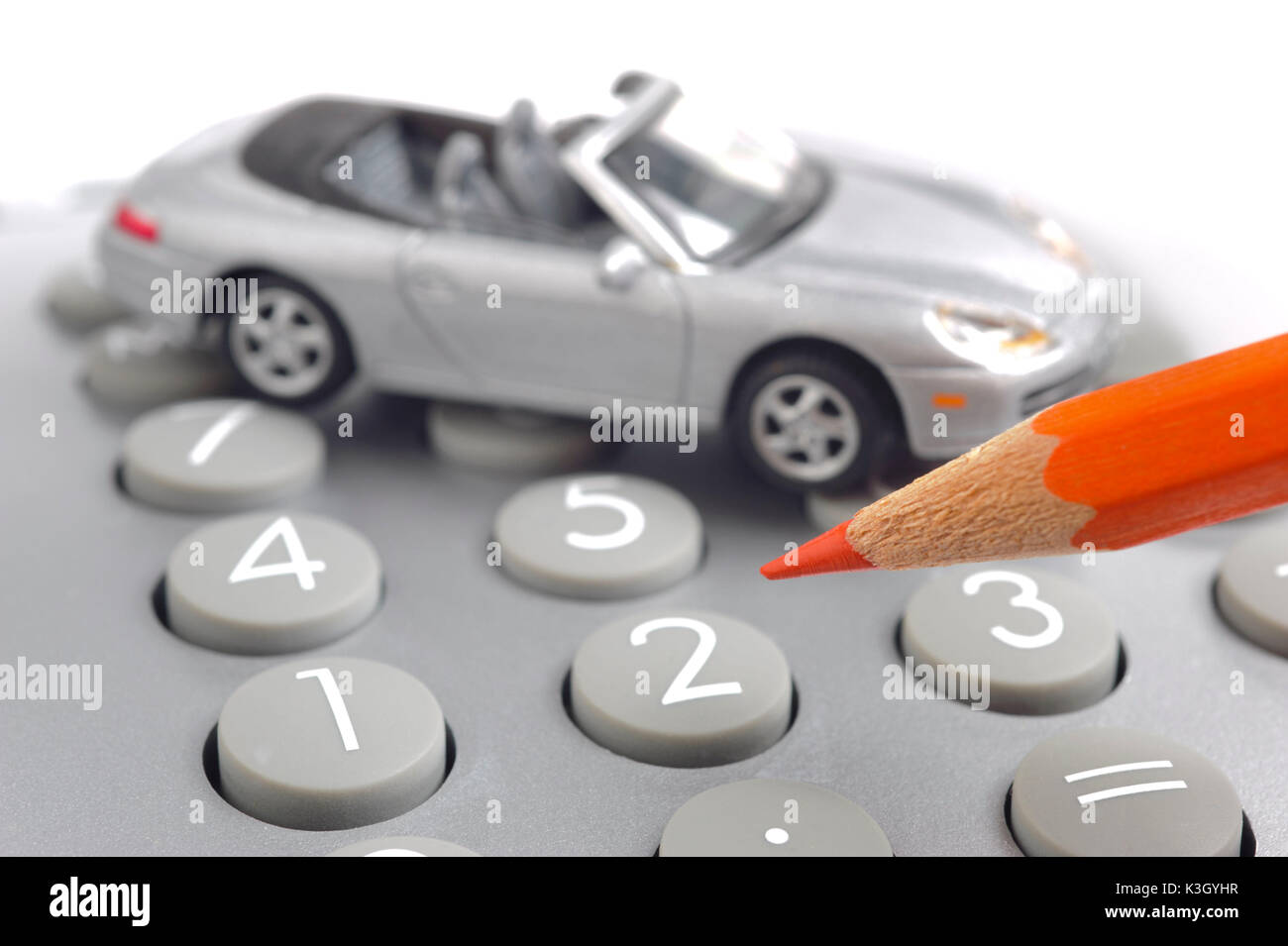 model car electronic calculator and red pen as an icon for rising