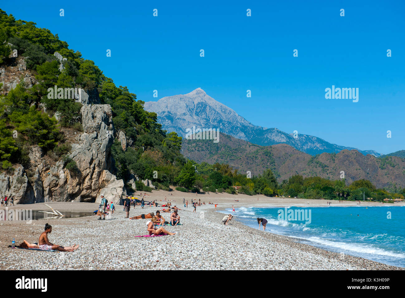 Turkey, Antalya, Cirali Köyü, beach of Olympos/Cirali, at the background in ancient times Mount Olympus called mountain Tahtali dagi - Stock Image