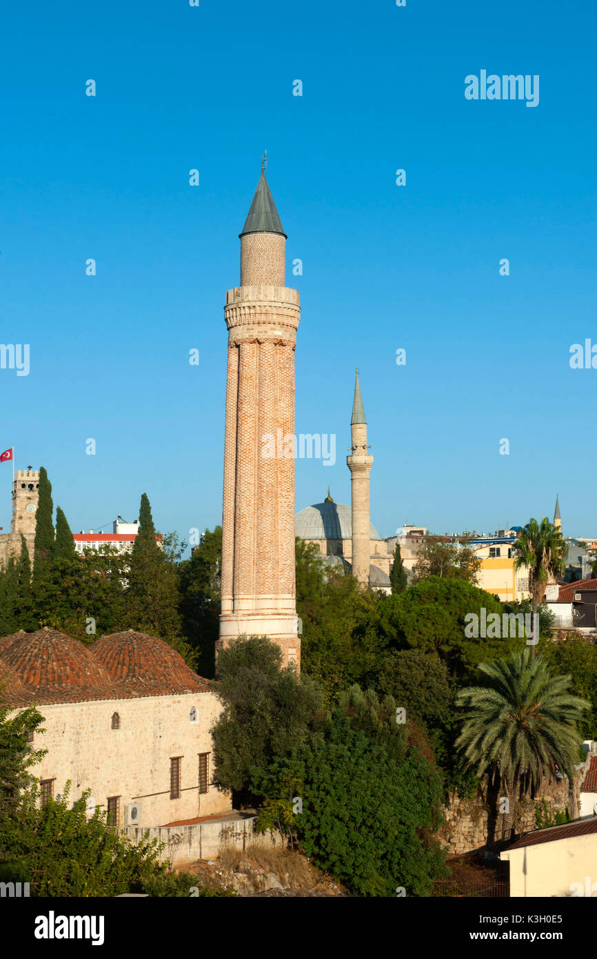 Turkey, Antalya, Alaaddin mosque close the Yivli Minare, on the left behind it dome and minaret of the Tekeli Mehmet Pasa Moschee - Stock Image