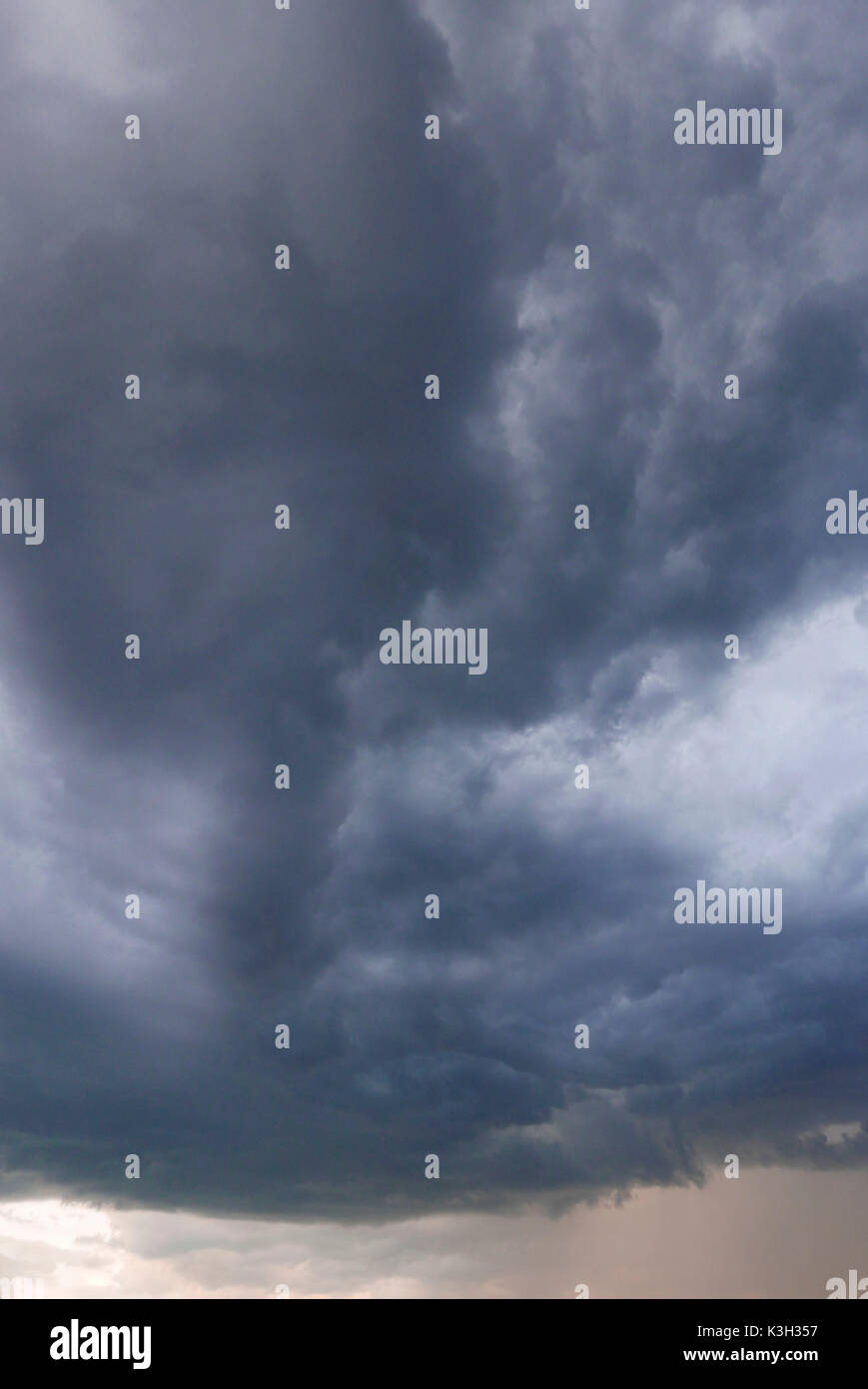 Thundery front, cloud motion in the evening of a sticky-hot summer day, - Stock Image