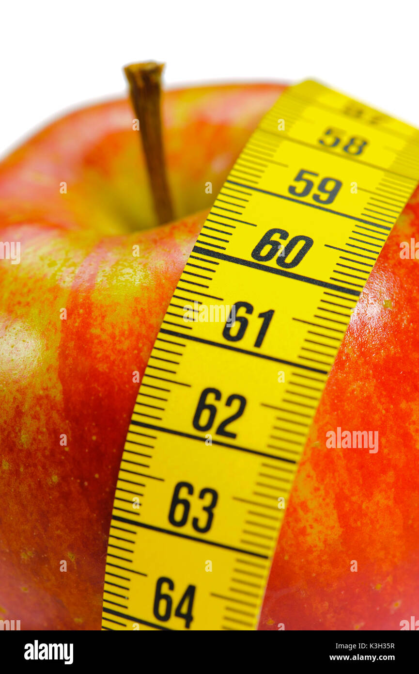 Apple as a slimming agent close tape measure, icon diet, dieting - Stock Image